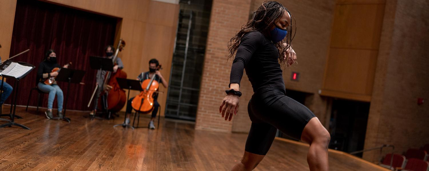 Dancer rehearses with string quintet in Ludwig Recital Hall