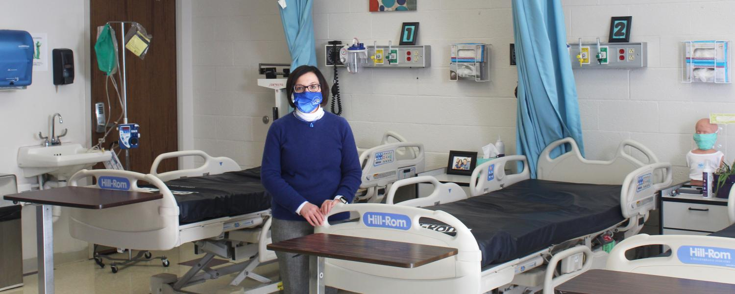 Melissa Owen with UH Geauga bed donations in lab