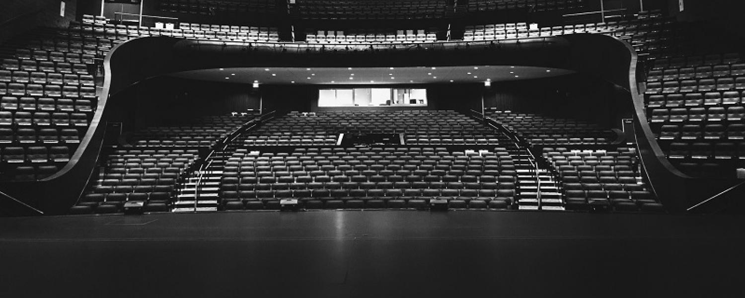Black and white photo of the PAC empty theater