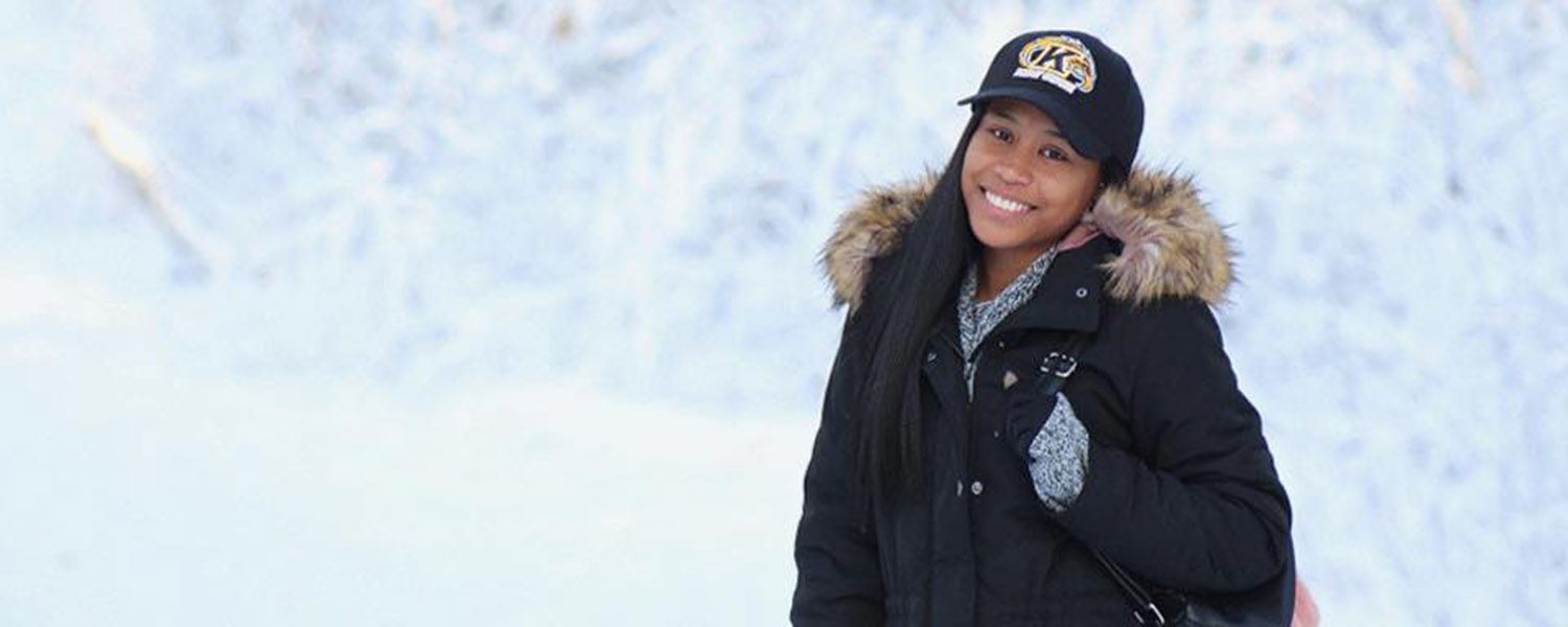 Kent State student Cepeda Woods, a fashion merchandising major, is pictured at Cheney Lake in Anchorage, Alaska. (Photo credit: Caroline Correche Towne)