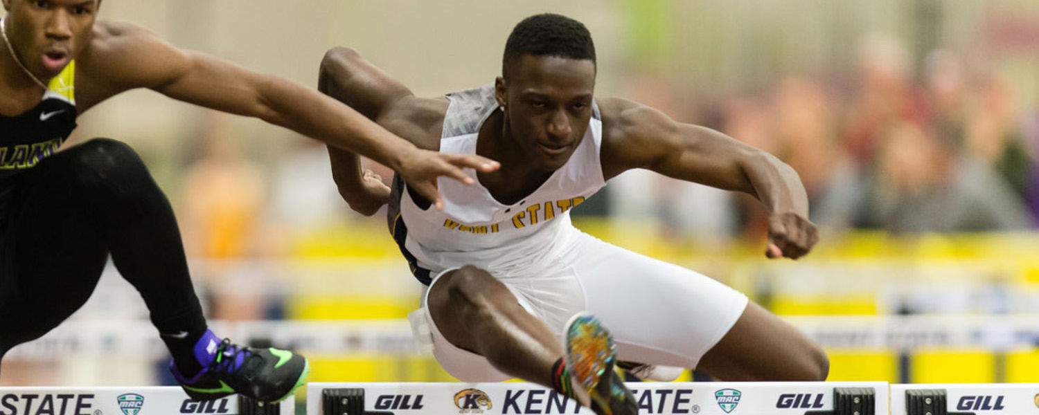 Kent State senior and track star Richard Dahome clears a hurdle.