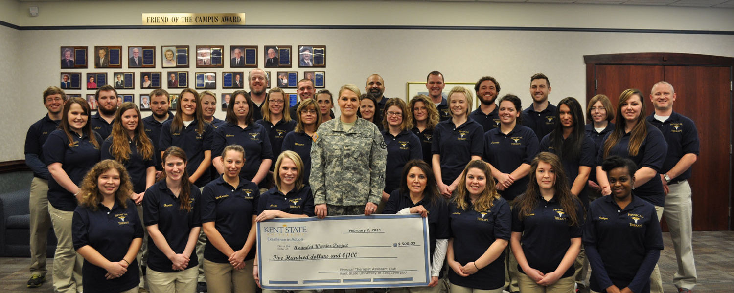 Students from the Kent State East Liverpool physical therapist assistant program present Sgt. Jada Butler, a first-year PTA student, with a check that will be forwarded to the Wounded Warrior Project, representing the results of their fundraising efforts.