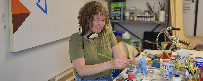 Painting graduate student in her studio