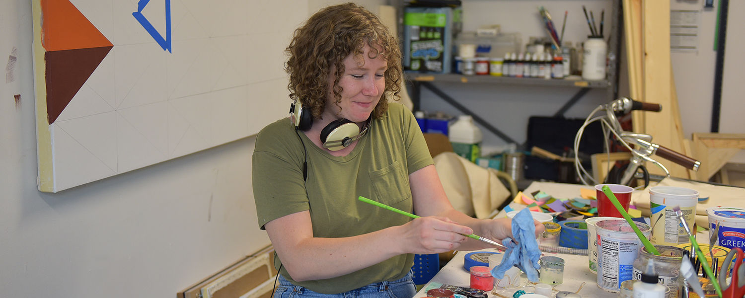 Painting graduate student in her studio
