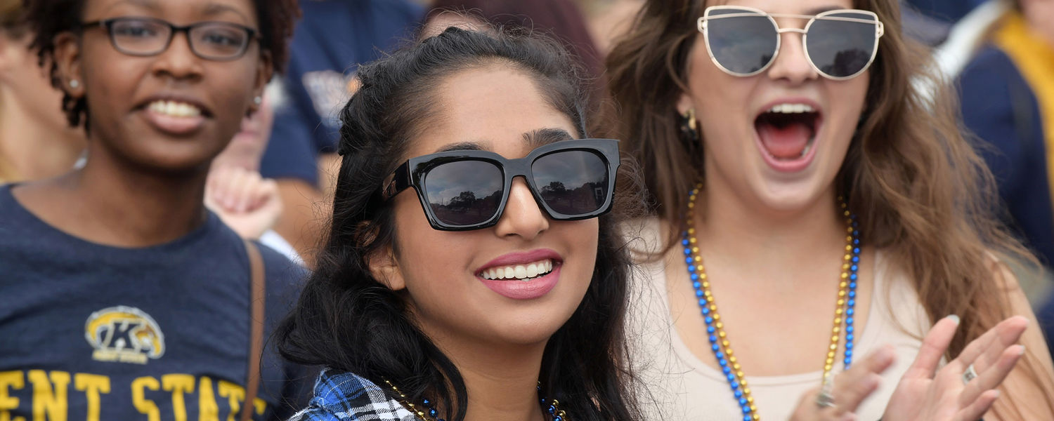 Kent State students react to participants in the 2018 Homecoming Parade as they make their way down Main Street in Kent, Ohio.