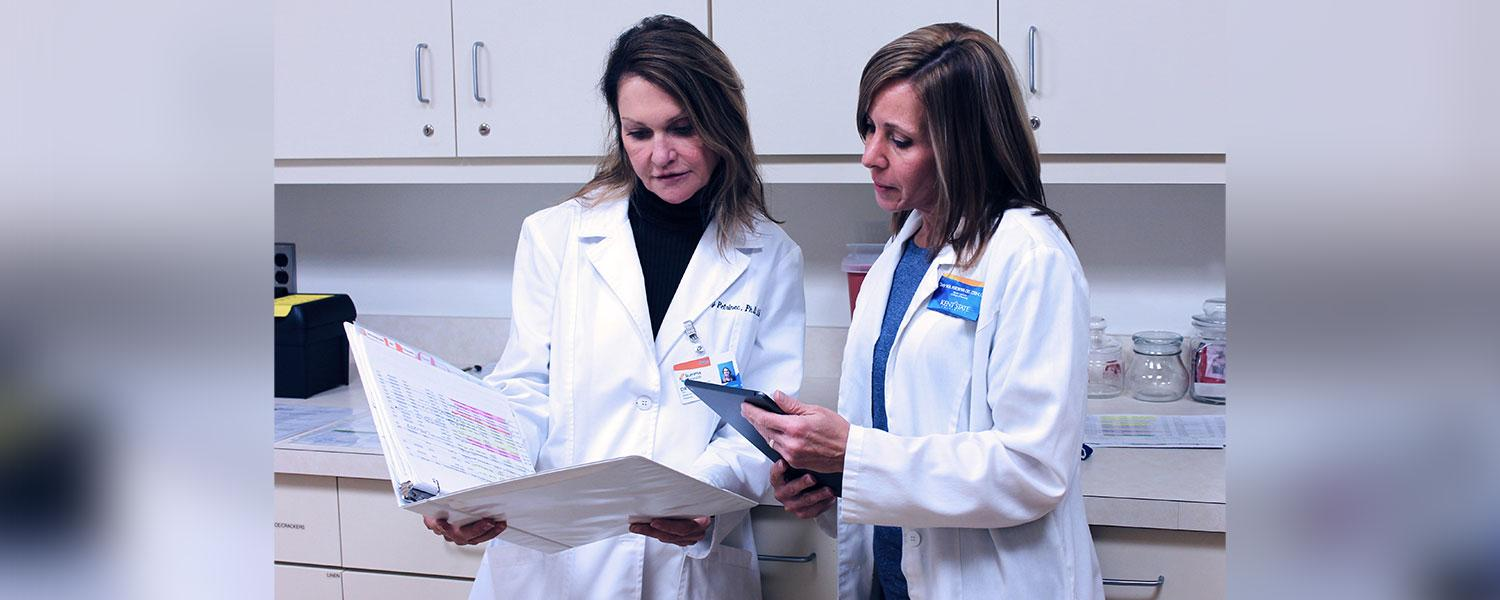Two nurse scientists discuss their findings.