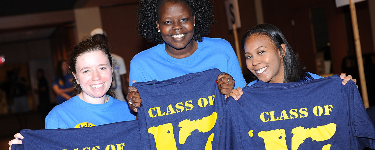 "Kent State University freshman students hold up ""Class of '17"" shirts they received during a Welcome Weekend event. For the Fall 2013 Semester, Kent State has set a new record."