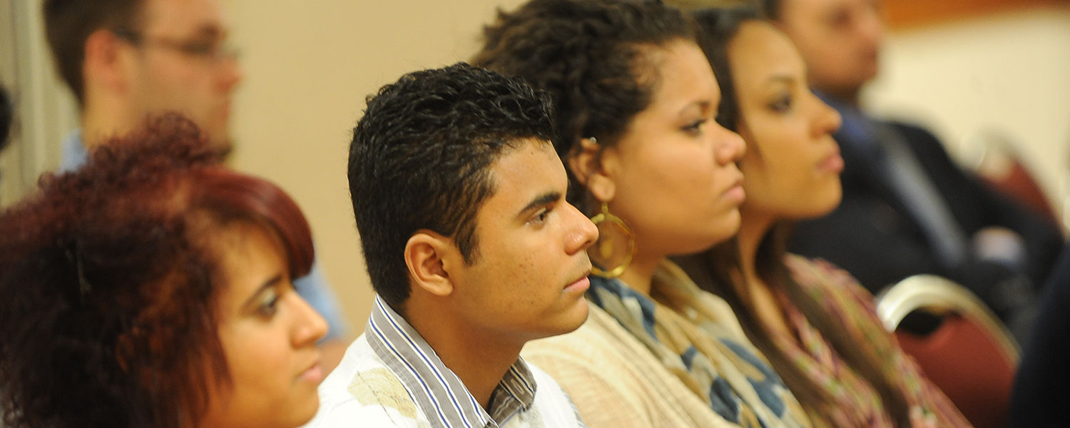 Attendees of the Hablemos (Let's Talk) Conference last year listen intently to the speaker.