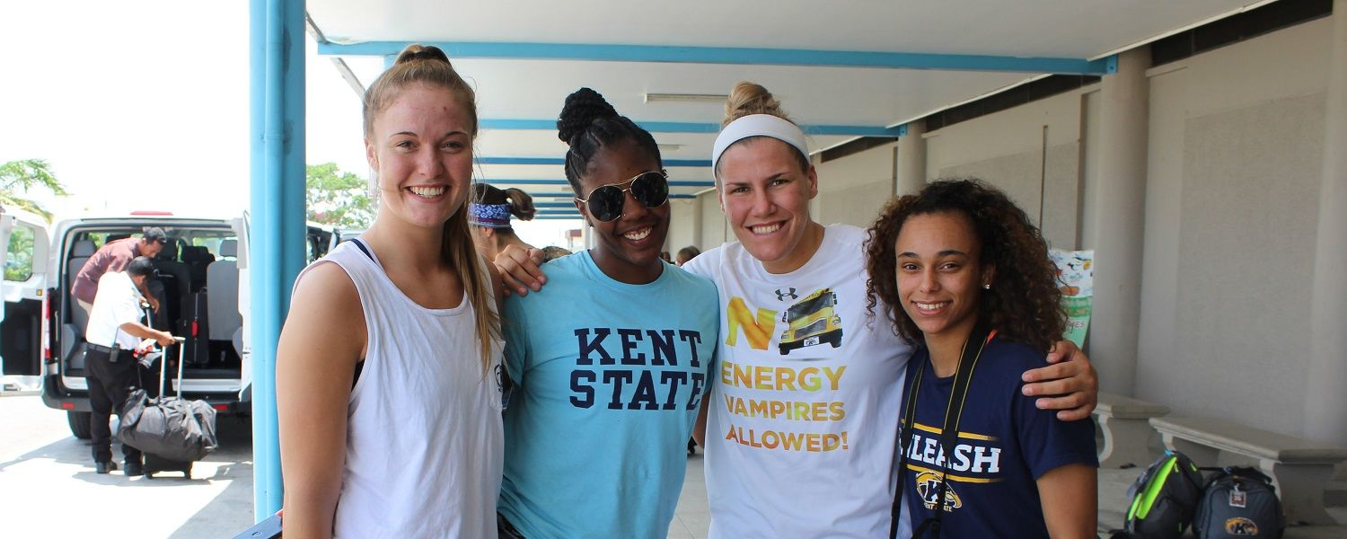 Kent State women's basketball student-athletes Jordan Korinek, Zenobia Bess, Lacey Miller and Taylor Parker pose following arrival in Aguacate, Belize.