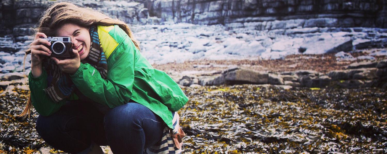 Image of Anna Hoffman holding camera courtesy of Photographer Alex Ledet