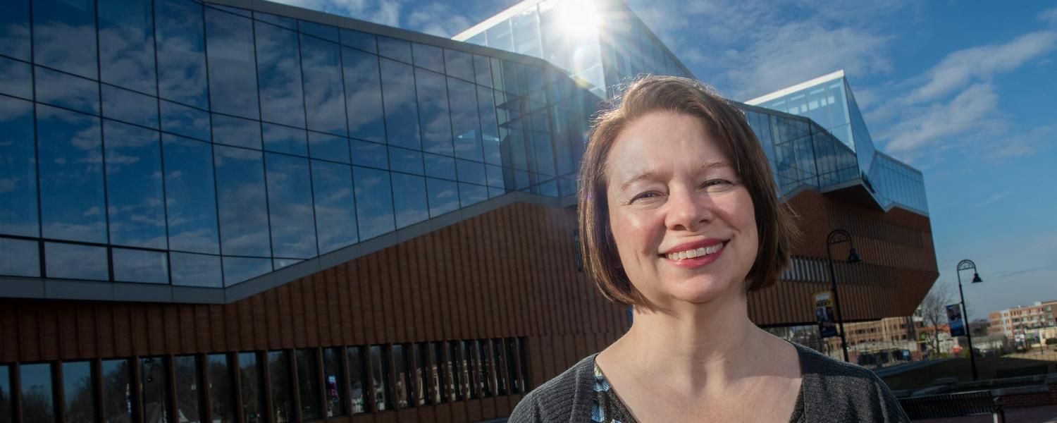 Melanie Knowles, Kent State University's manager of sustainability, stands in front of her favorite building on campus, The John Elliott for Architecture and Environmental Design.