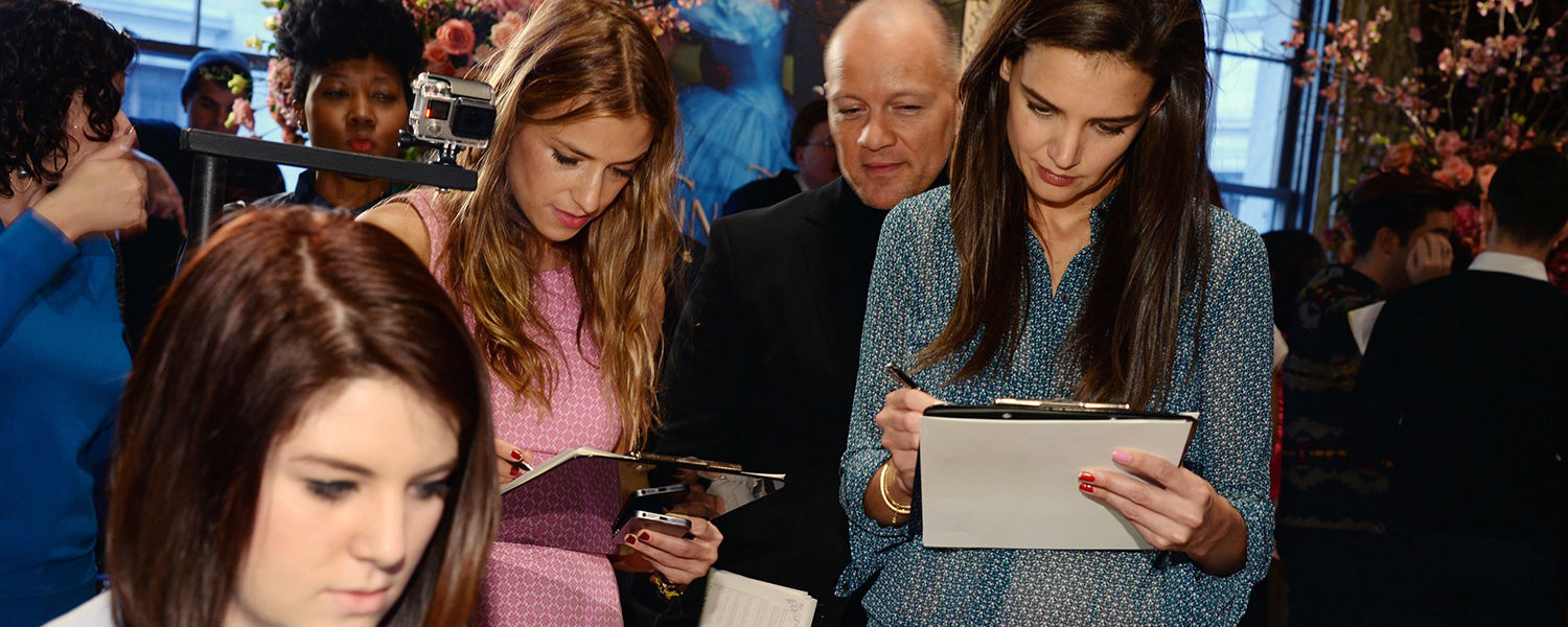 A Kent State student (seated) has her work reviewed by a team of judges, including (from left to right standing) designer Charlotte Ronson, designer Geoffrey Henning and actress Katie Holmes. (Photo by Patrick McMullen, courtesy of JC Penney.)