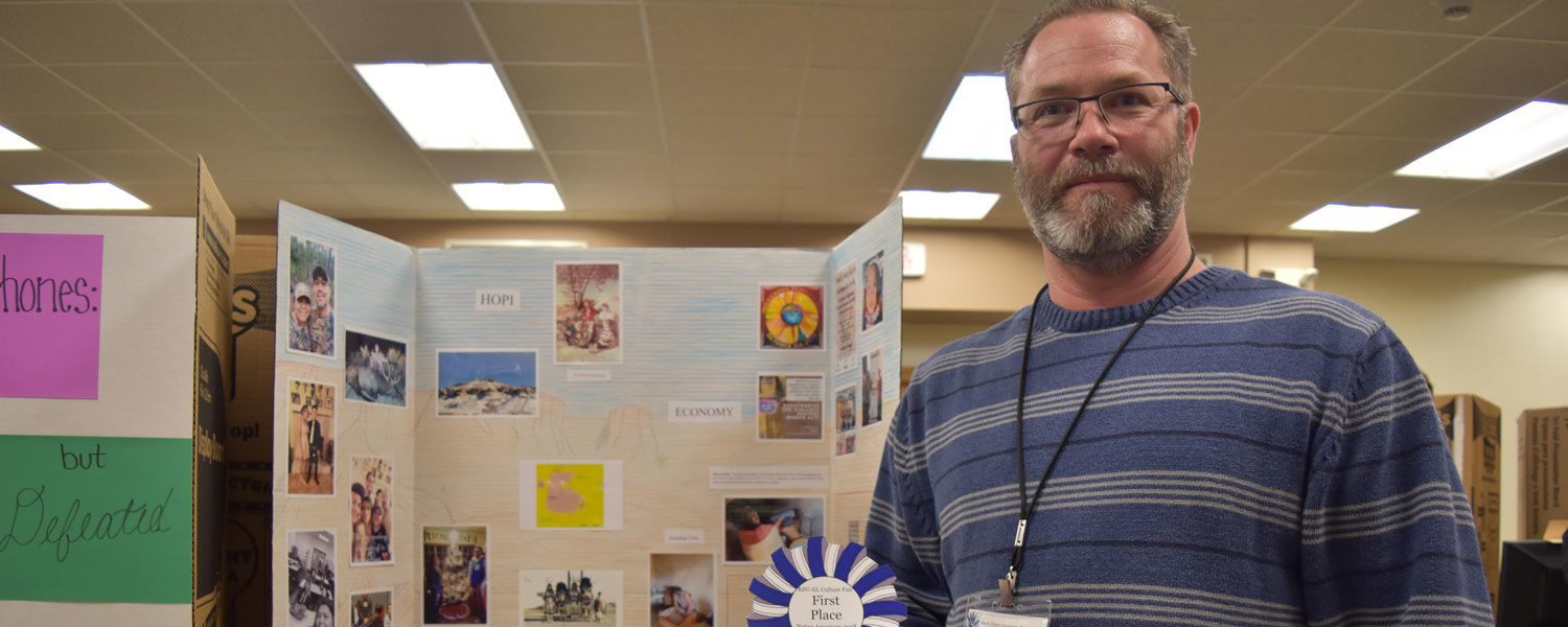 Anthony D'Urso with his winning poster featuring the HOPI culture.