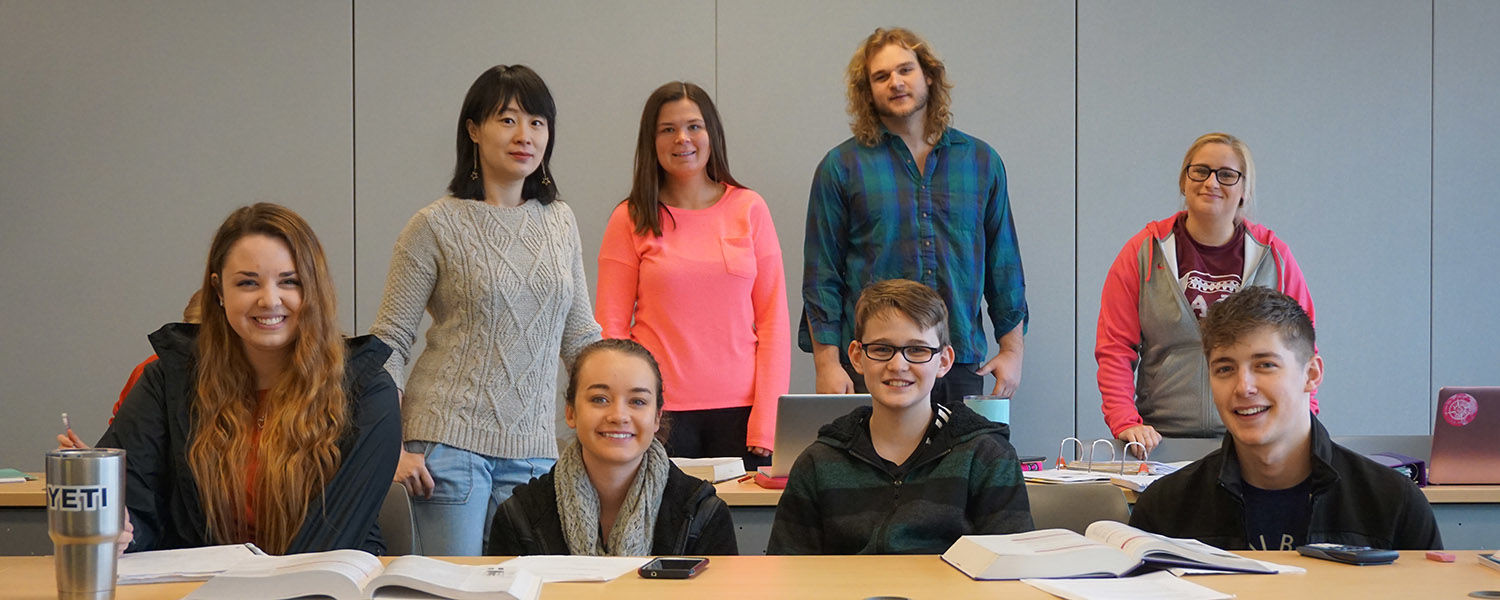 Jameson Payne sits with his fellow students at Kent State's Regional Academic Center in Twinsburg.