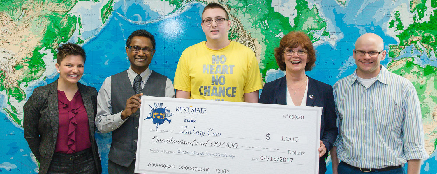 Zachary Cino, center, is a winner of a $1,000 scholarship to study abroad.