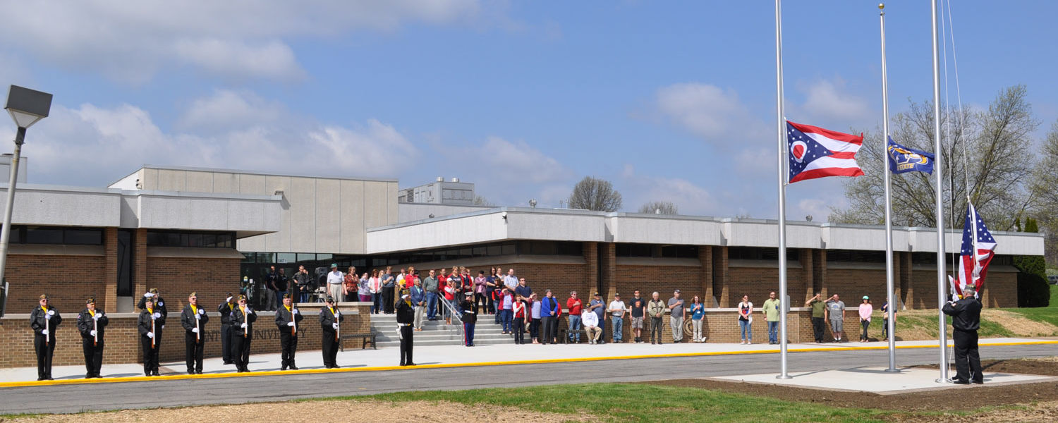 Flag raising ceremony at the new front entrance to Kent State University at Salem.