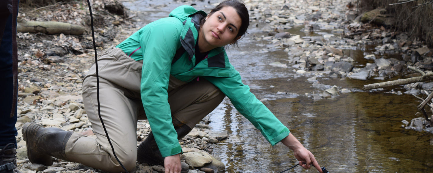 Raissa Mendonca gets a sample of the water at West Branch State Park as part of a biogeochemistry project at Kent State University. (Photo taken by Jim Maxwell)