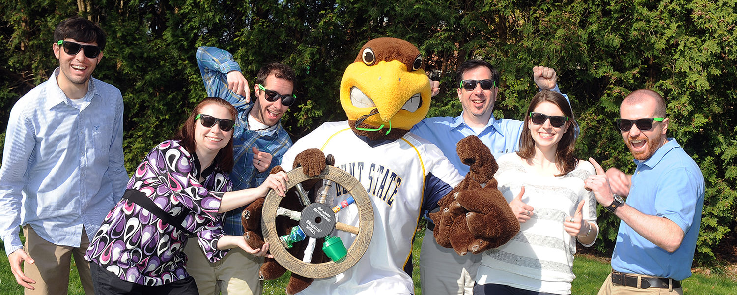 Kent State mascot Flash and the university's RecycleMania team pose with the Braggin' Wheel, won in last year's informal recycling competition with the University of Akron.