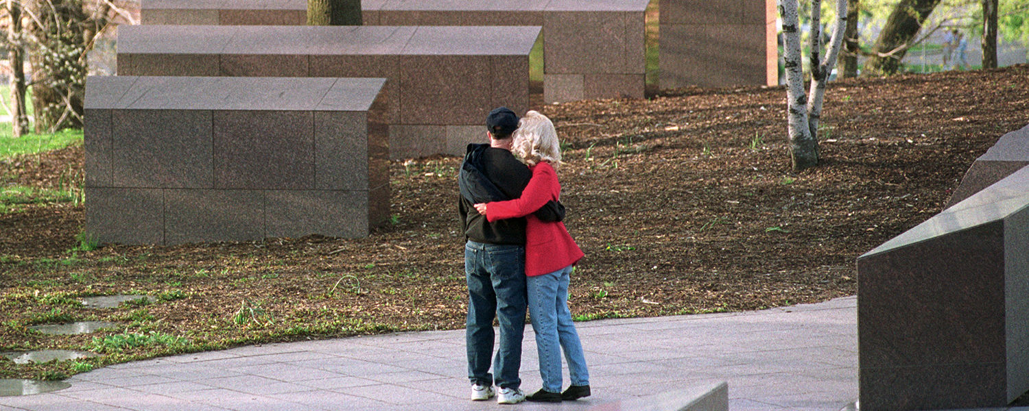 Visitors share a quiet moment at the site of the Kent State May 4 Memorial. Four students were killed on May 4, 1970, during a student protest of the Vietnam War.