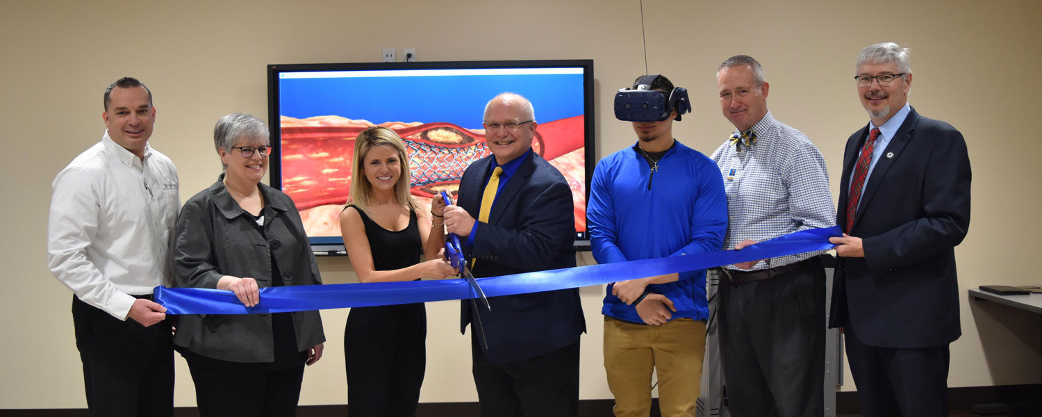 Cutting the ribbon for the Virtual Reality classroom at East Liverpool April 2109