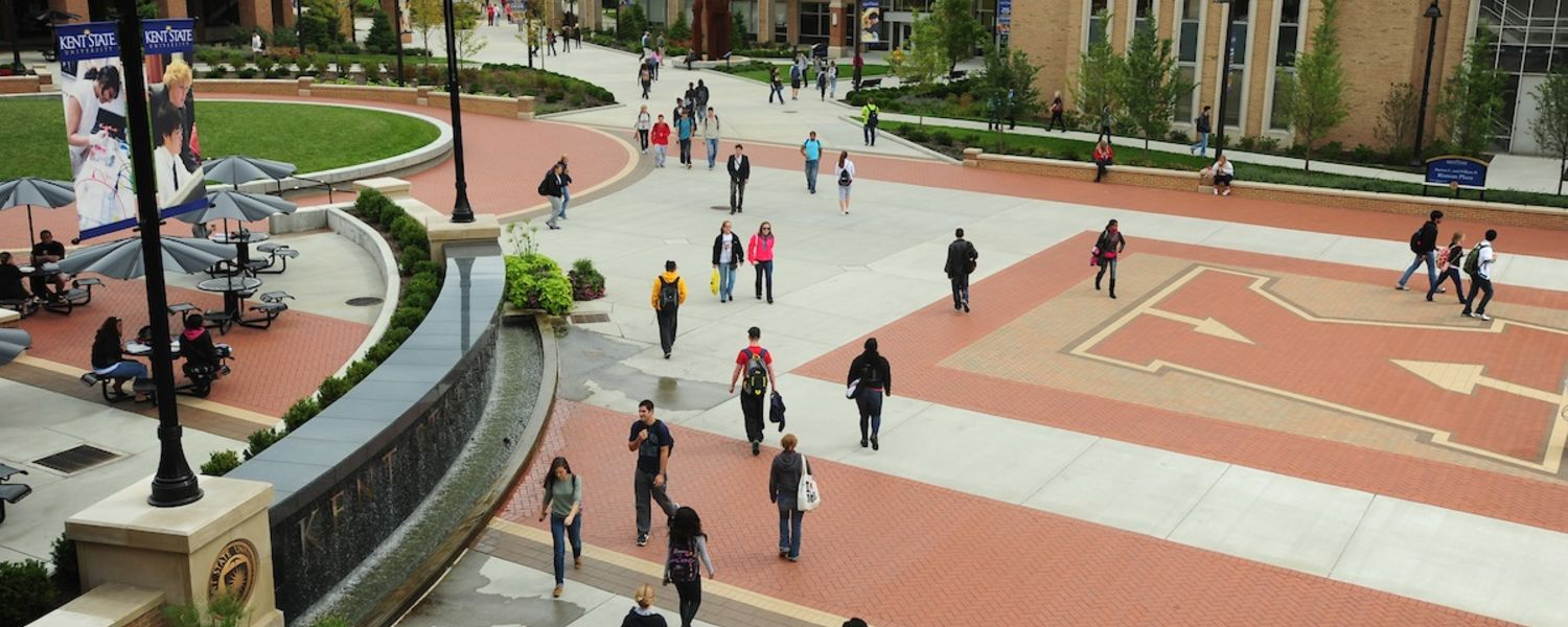 Kent State University students walk to and from class on Risman Plaza.