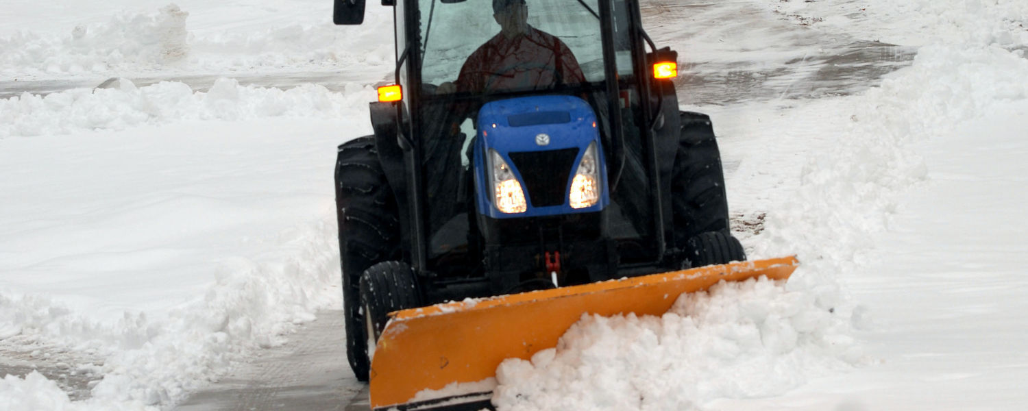 A member of the grounds crew plows snow from walkways on the Front Campus area of the Kent Campus during a winter snowstorm.