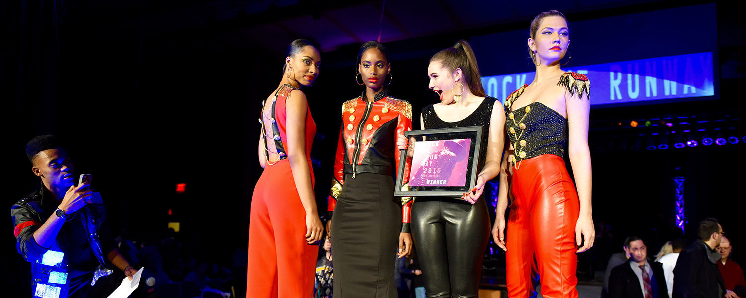 Kent State student Kelly Neiser (second from right) poses for pictures with her models after being announced as the Judges' Choice and winner of a $2,500 scholarship. (Photo credit: Thomas Farmer Photography)