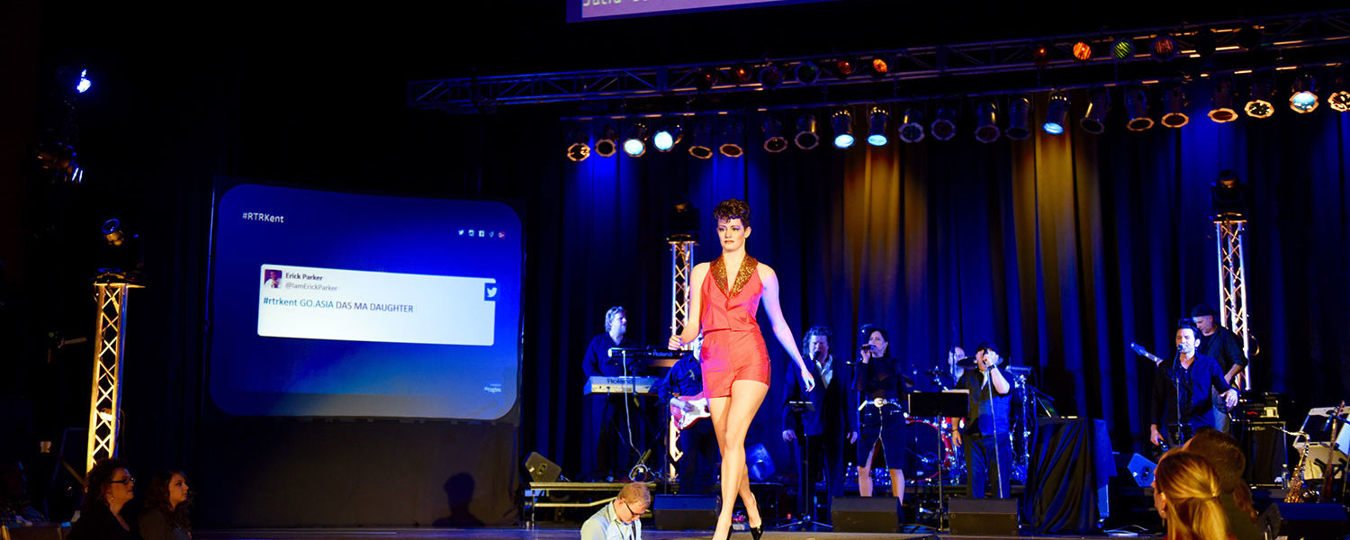 One of the outfits from the Audience Choice winner's collection walks the runway while the band Decadia plays music from The Jacksons. (Photo credit: Thomas Farmer Photography)