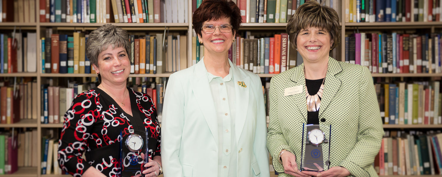 Staff Excellence Award recipients for 2018 are Theresa Huart (left) and Shaan Fowler (right), pictured with Dean Denise Seachrist (center).