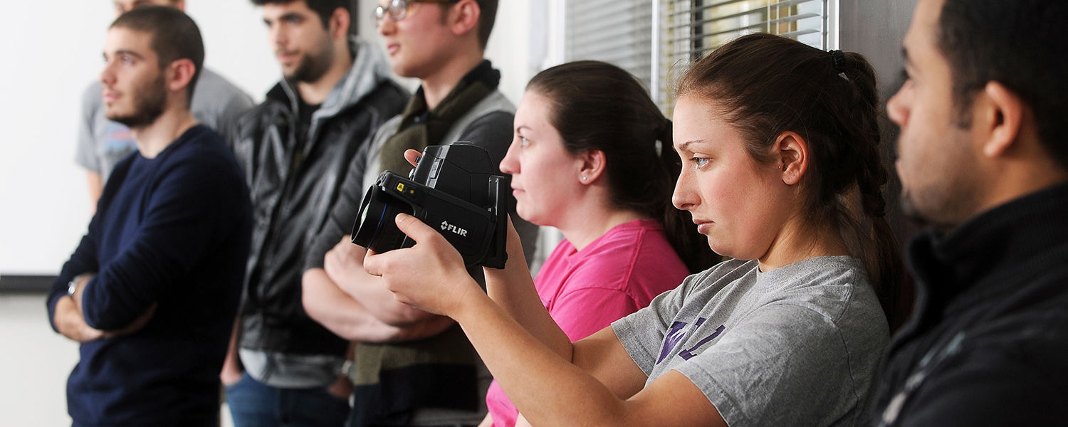 Students in Elwin Robison's architecture class take turns using a thermal imaging camera in Taylor Hall.
