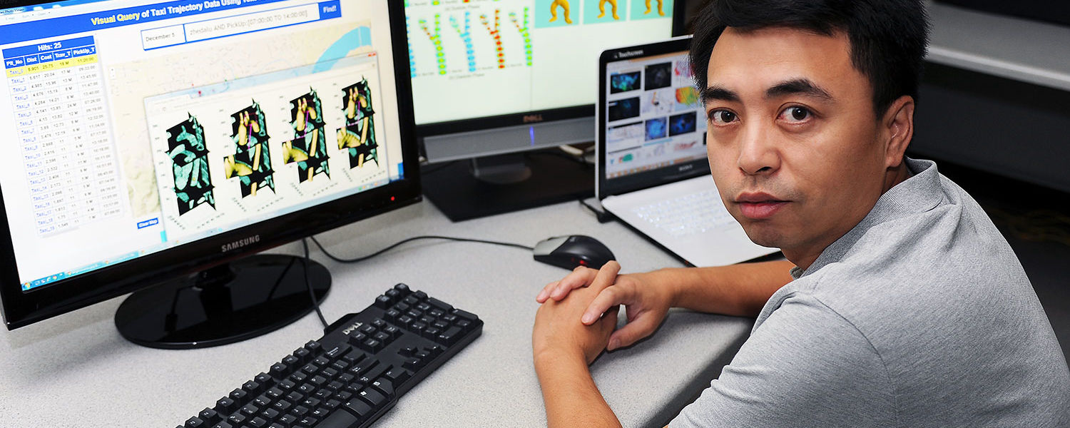 Ye Zhao, associate professor of computer science in the College of Arts and Sciences, works on research in a lab in the Mathematics and Computer Science Building.