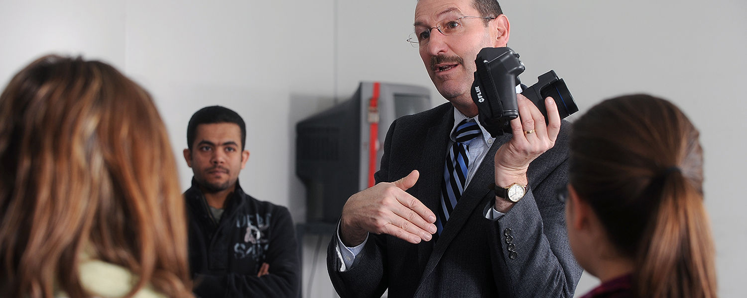Elwin Robison, a professor in Kent State's College of Architecture and Environmental Design, explains the operation of a thermal imaging camera to his architecture class in Taylor Hall.