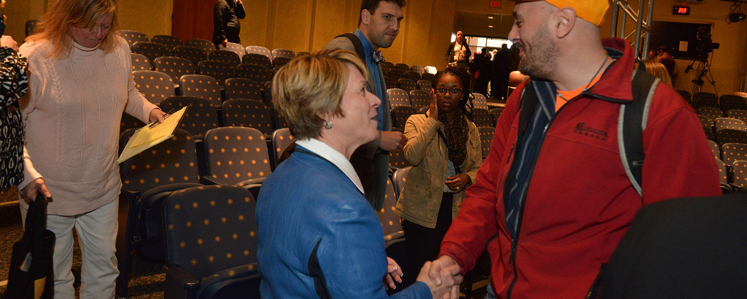 Kent State President Beverly Warren talks with an attendee following the State of the University address.