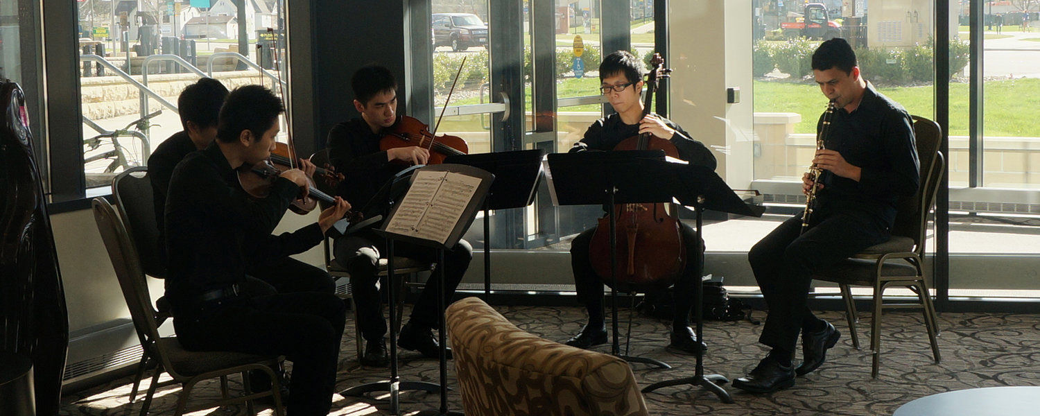 Tiago Delgado (far right) performs with the Stopper String Quartet at the 2016 International Symposium.