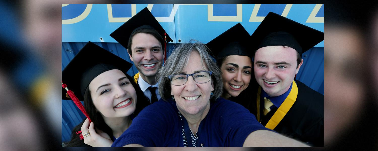 Sue Zake at Graduation ceremony with students