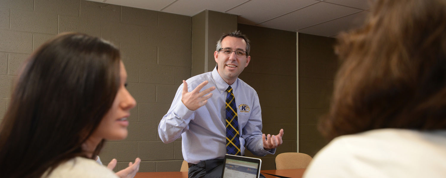 Jeffrey Child, associate professor of communication and associate director of the School of Communication Studies in the College of Communication and Information, teaches a class on the first floor of Taylor Hall.