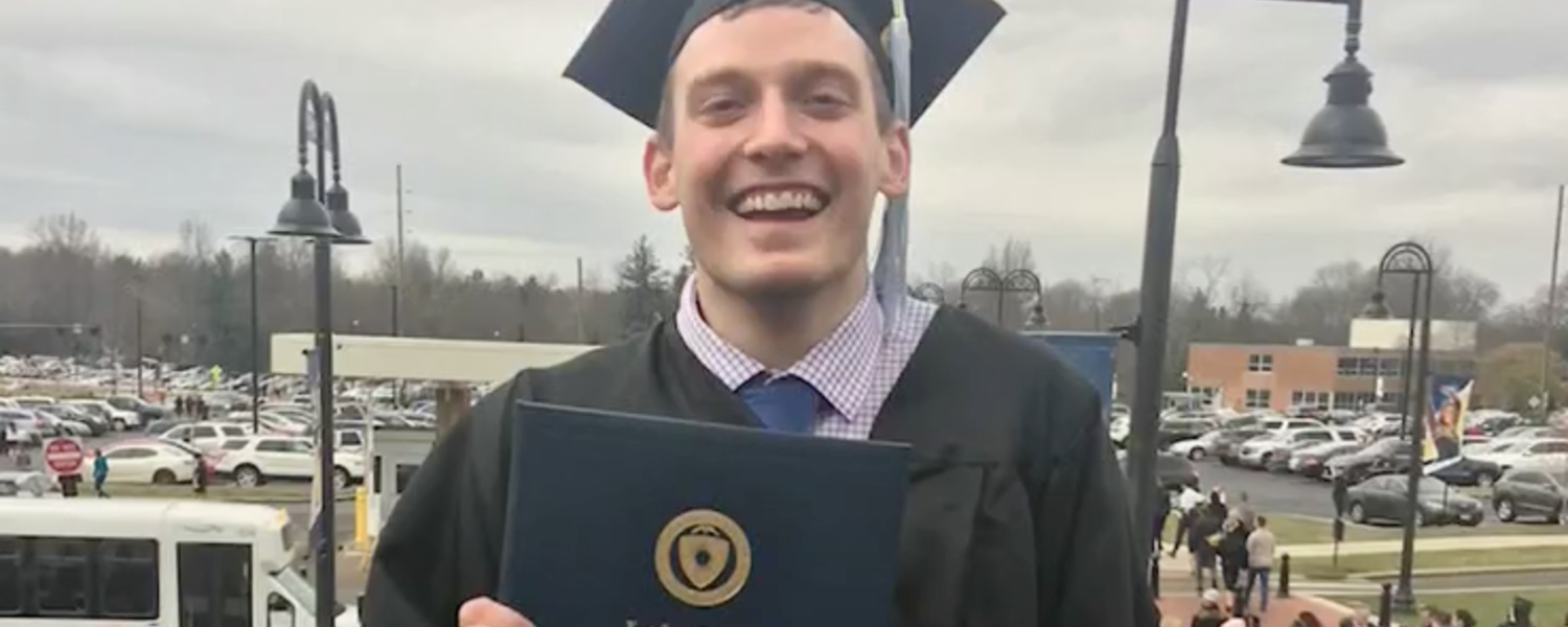 Kent State graduate Garrett Holubeck overcame cancer to earn his degree.