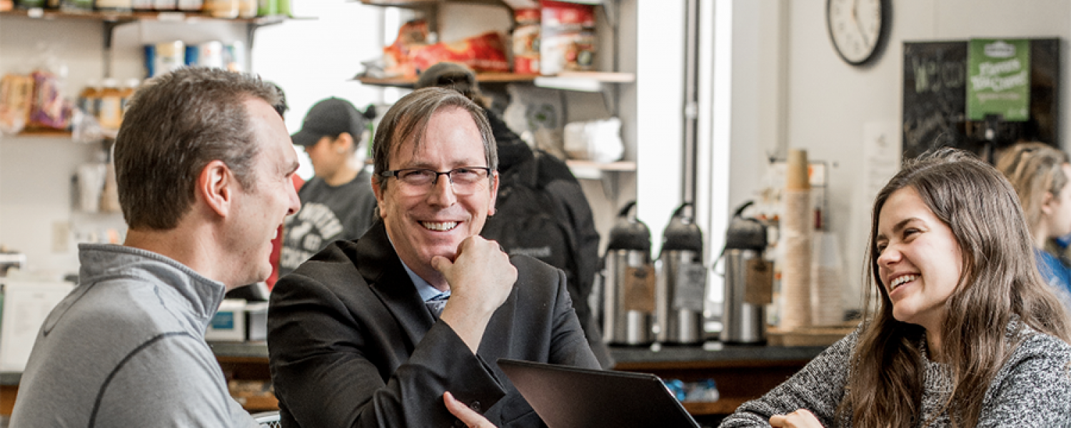 Dean in cafe with students