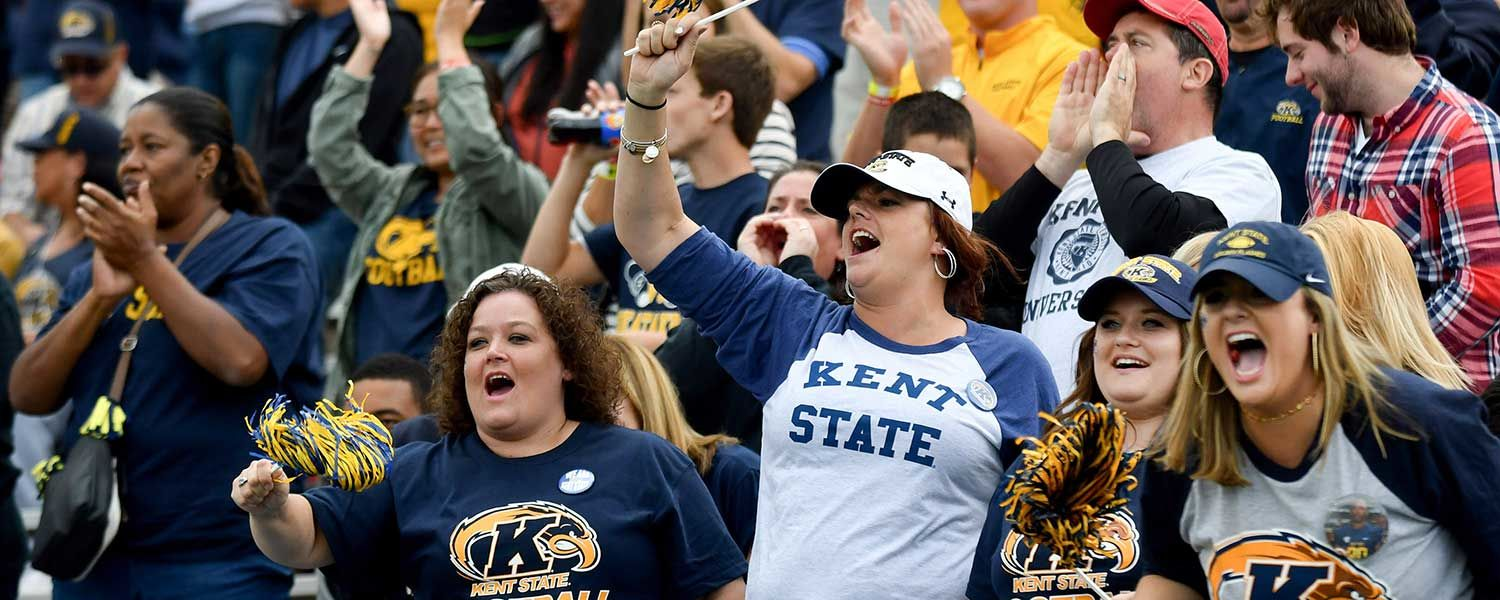 Fans of the Kent State football team cheer on their Golden Flashes during a 2016 game against the Akron Zips.