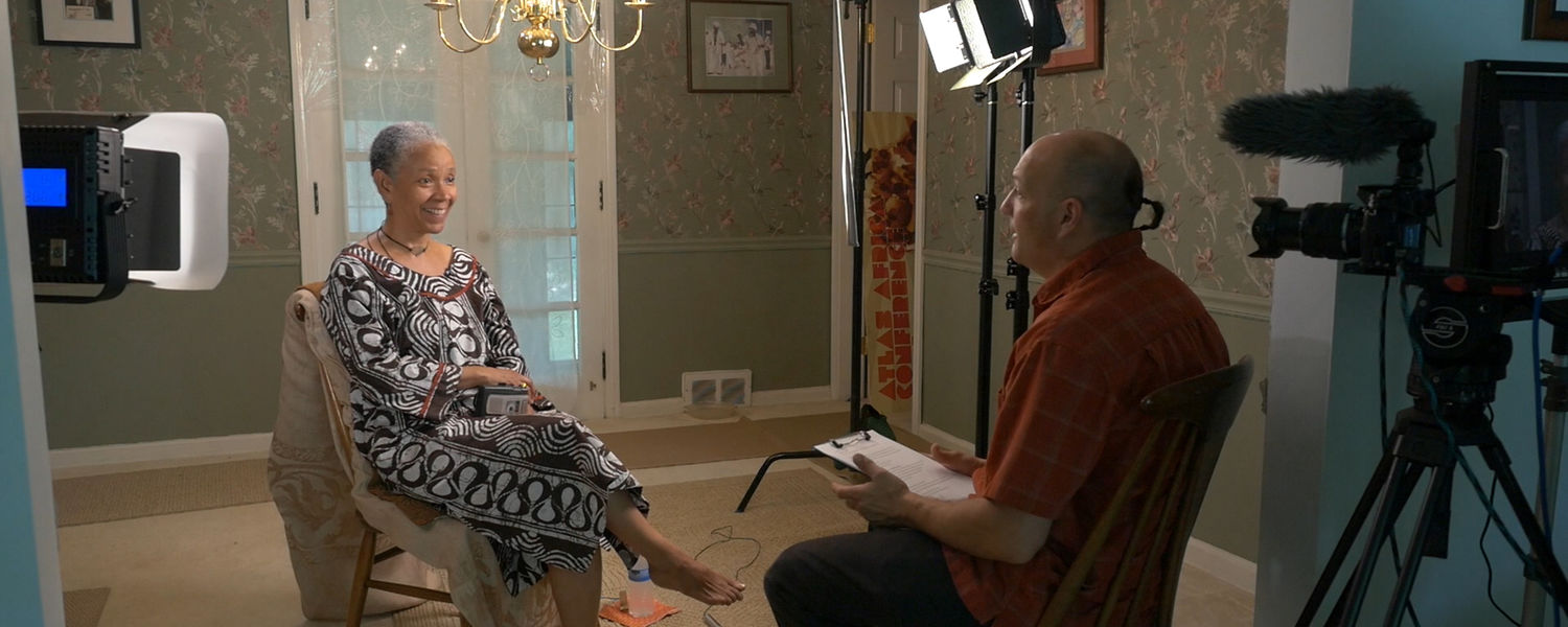 TeleProductions' Shane Roach interviews professor Joanne Kilgour Dowdy, Ph.D., for a documentary being released next year.