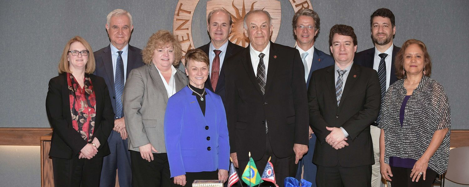 Administrators from both Kent State University and Pontifical Catholic University of Paraná gather for a group photograph following signing ceremony between the two universities.