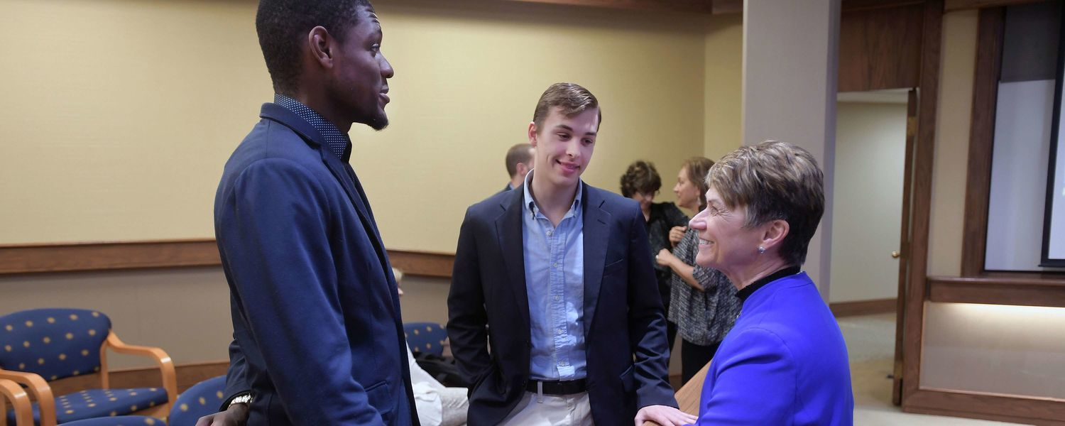 Kent State University President Beverly J. Warren speaks with Brazilian Kent State students following the signing ceremony between Kent State and Pontifical Catholic University of Paraná.