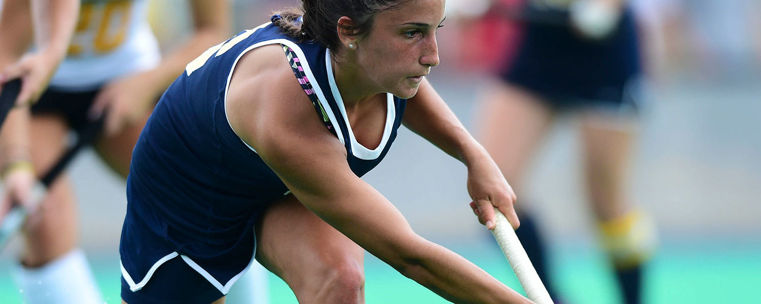 Silvia Figa Malgosa, sophomore nutrition major from Spain, dribbles the ball during a Kent State field hockey game.