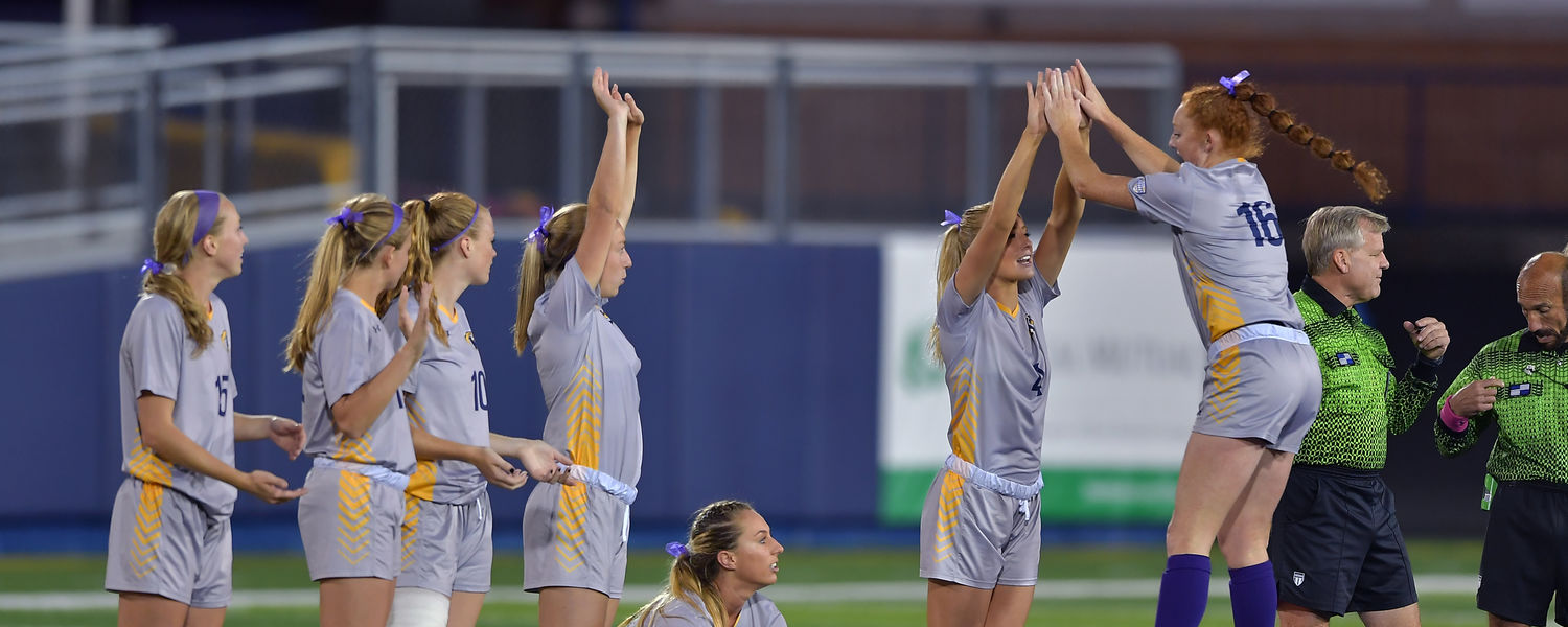 Kent State's Maddie Holmes (16) high-fives her teammates before Kent State's 1-0 win over Toledo on Oct. 19.
