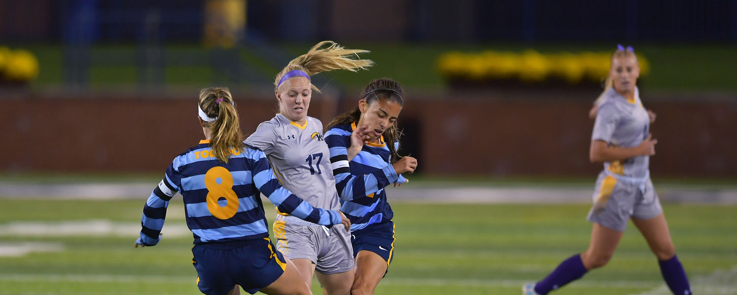 Kent State's Amanda Reed battles for a ball between two Toledo defenders in the Golden Flashes' 1-0 win over Toledo on Oct. 19.