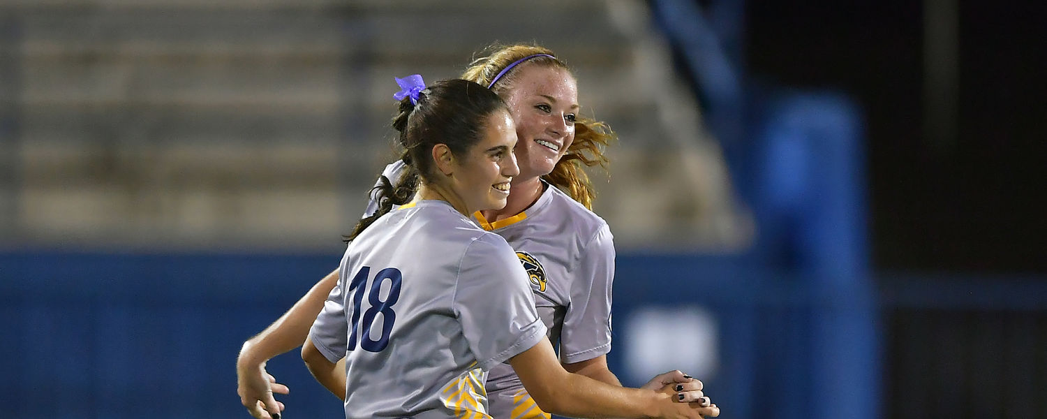 Kent State's Paige Culver (10) congratulates Vital Kats (18) on her game-winning goal in Kent State's 1-0 win over Toledo on Oct. 19.