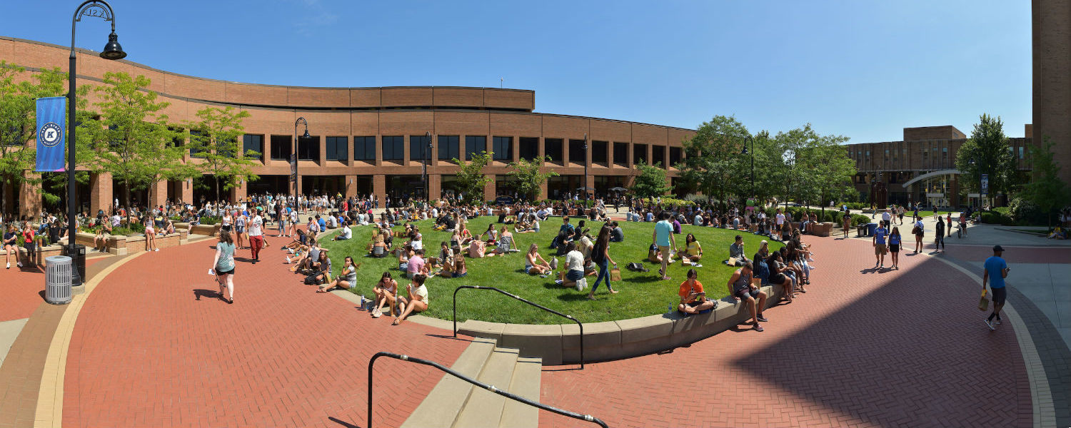 Students gather by the green in front of Kent Student Center