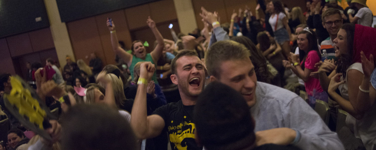 The crowd celebrates after the total amount raised for SAVE was announced at this year's Songfest.