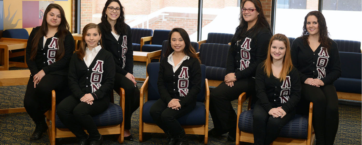 Members of Lambda Theta Nu, Kent State's first Latina sorority, pose for a group photo in the Student Multicultural Center on the second floor of the Kent Student Center.