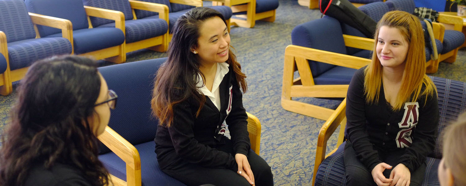 Members of Kent State's first Latina sorority share a light moment while spending time in the Student Multicultural Center in the Kent Student Center.